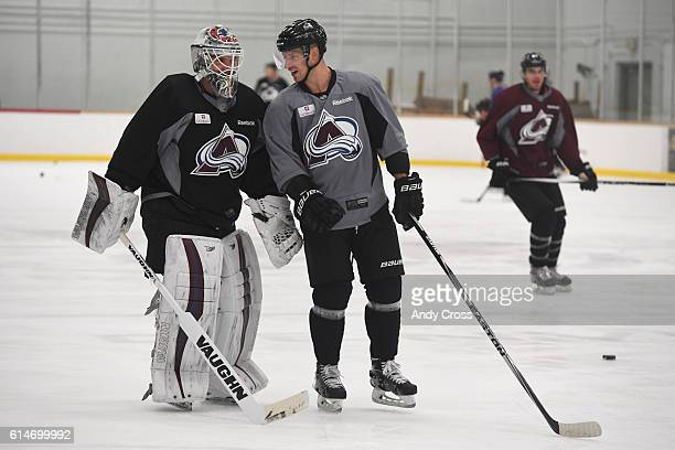 Colorado Avalanche left wing Blake Comeau right has a laugh with goalie Calvin Pickard during practice at the Family Sports Center October 14 2016