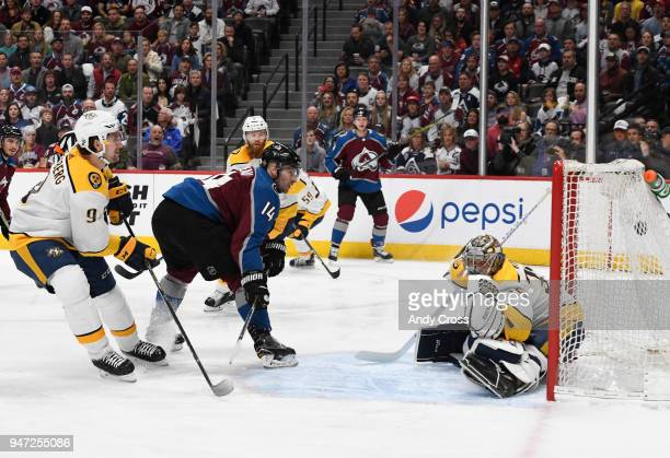 Colorado Avalanche left wing Blake Comeau shoots and scores against Nashville Predators goaltender Pekka Rinne in the first period during the third...