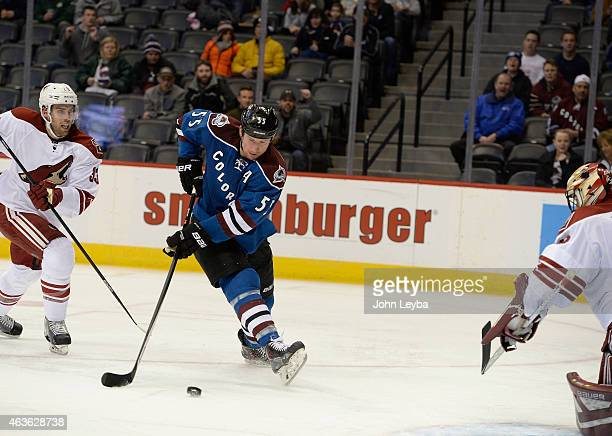 Colorado Avalanche left wing Cody McLeod backhands a shot on Arizona Coyotes goalie Mike McKenna for a goal during the first period February 16 2015...
