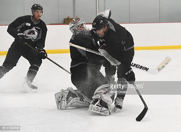 Colorado Avalanche left wing Gabriel Bourque crashes into goalie Colorado Avalanche goalie Calvin Pickard during practice at the Family Sports Center...
