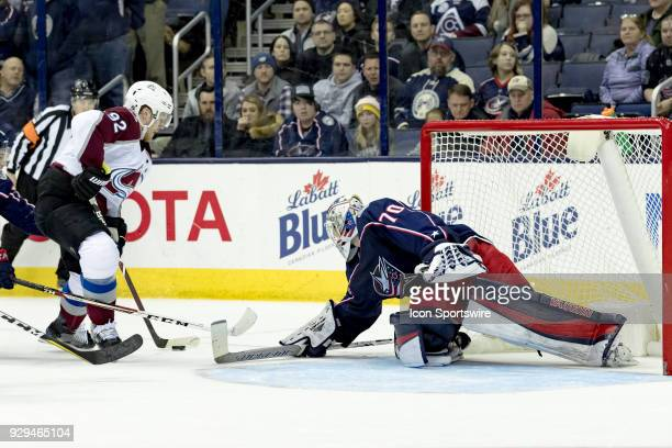 Colorado Avalanche left wing Gabriel Landeskog attempts a shot on goal as Columbus Blue Jackets goaltender Joonas Korpisalo lays a stick down to...