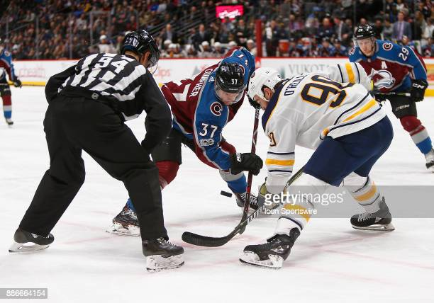 Colorado Avalanche left wing JT Compher and Buffalo Sabres center Ryan O'Reilly faceoff during a regular season game between the Colorado Avalanche...