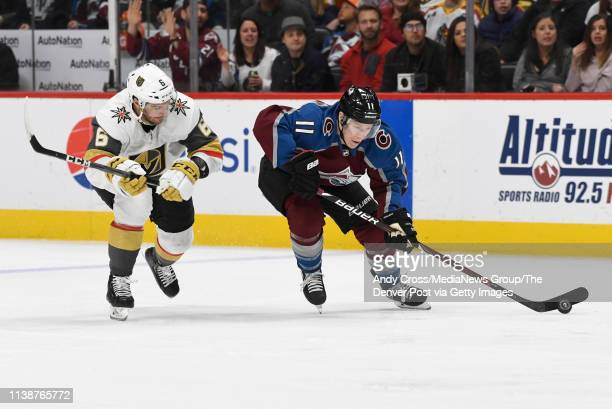 Colorado Avalanche left wing Matt Calvert gains control of the puck against Vegas Golden Knights defenseman Colin Miller in the third period at the...