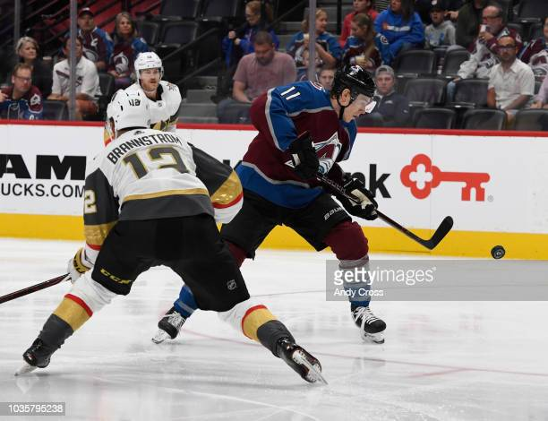 Colorado Avalanche left wing Matt Calvert tries to get control of the puck against Vegas Golden Knights defenseman Erik Brannstrom in the second...