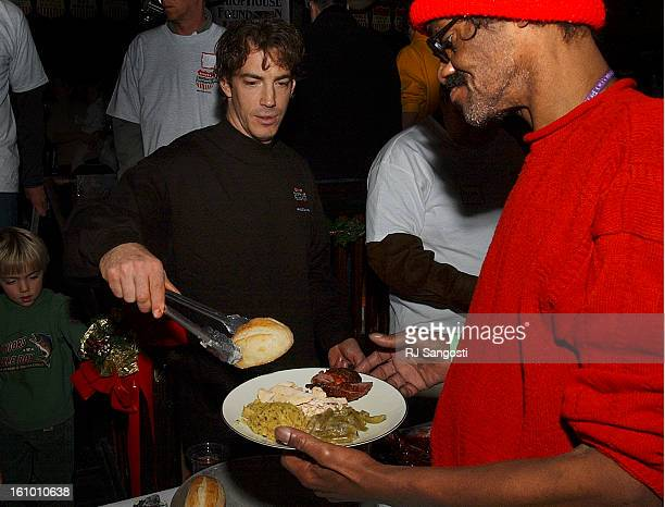 Colorado Avalanche player Joe Sakic serves food Saturday Dec 25 during the annual Miracle on 19th Street an event that provides a holiday meal flu...