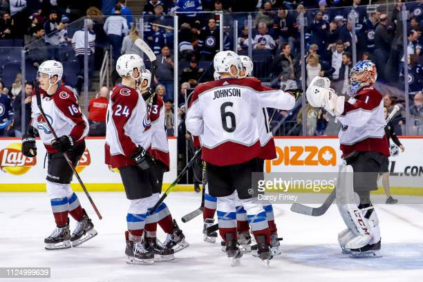 Colorado Avalanche players celebrate following a 41 victory over the Winnipeg Jets at the Bell MTS Place on February 14 2019 in Winnipeg Manitoba...