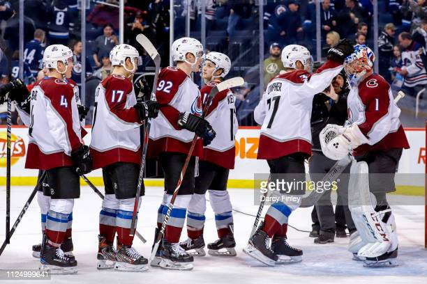 Colorado Avalanche players congratulate goaltender Semyon Varlamov following a 41 victory over the Winnipeg Jets at the Bell MTS Place on February 14...
