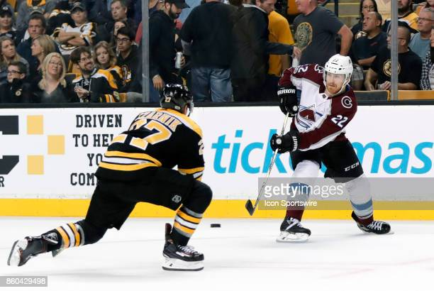 Colorado Avalanche right wing Colin Wilson passes away from Boston Bruins center Austin Czarnik during a game between the Boston Bruins and the...