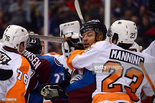 Colorado Avalanche right wing Jarome Iginla gets put in a headlock by Philadelphia Flyers defenseman Brandon Manning during the third period at the...