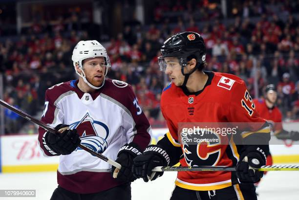 Colorado Avalanche Right Wing JT Compher keeps an eye on Calgary Flames Left Wing Johnny Gaudreau during the second period of an NHL game where the...