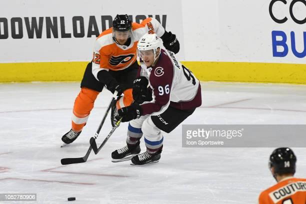 Colorado Avalanche Right Wing Mikko Rantanen battles Philadelphia Flyers Left Wing Michael Raffl for possession during the regular season game...