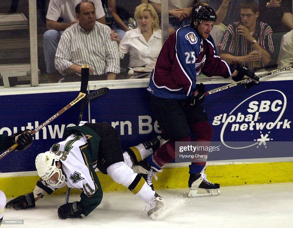 Colorado Avalanche Shjon Podein puts a check on Dallas Stars Blake Sloan during the first period of the Western Conference Finals in Dallas. : News Photo