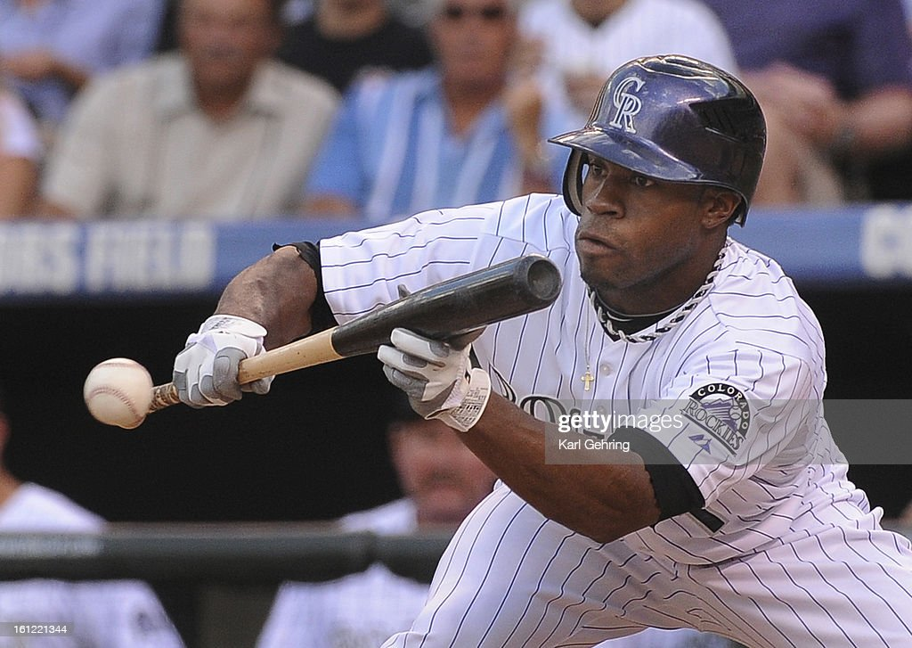Colorado batter Eric Young Jr. considers a bunt in the third inning. The Colorado Rockies hosted the Washington Nationals at Coors Field Saturday night, August 6, 2011. Karl Gehring/ The Denver Post