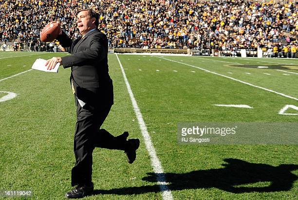 BUFFS31 Colorado Buffaloes AD Mike Bohn tosses a ball to fans before CU take on the Missouri Tigers Saturday at Folsom Field RJ Sangosti/ The Denver...