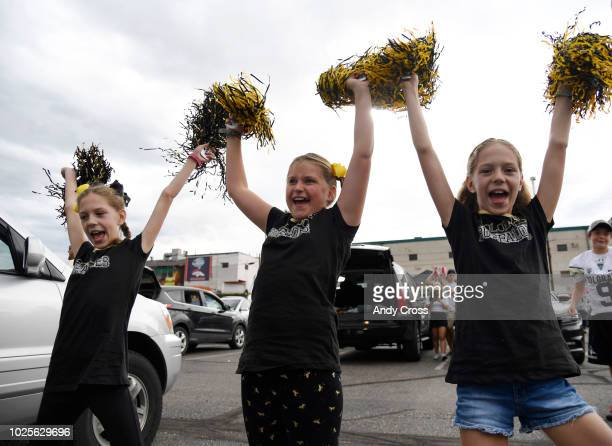Colorado Buffaloes fans from left to right Madison Crist Savannah Mahoney Kaitlin Crist perform a cheer before the Rocky Mountain Showdown featuring...