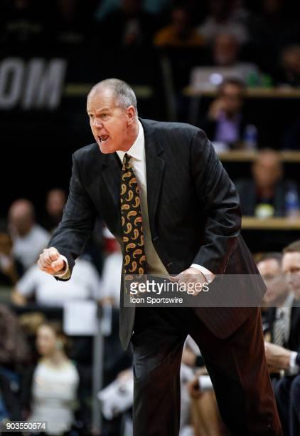 Colorado Buffaloes head basketball coach Tad Boyle signals in a play for his team during their regular season PAC12 basketball game against Arizona...