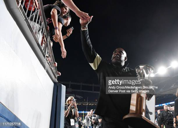 Colorado Buffaloes head coach Mel Tucker holds the Centennial Cup while celebrating with fans after defeating the Colorado State Rams 5231 to win the...