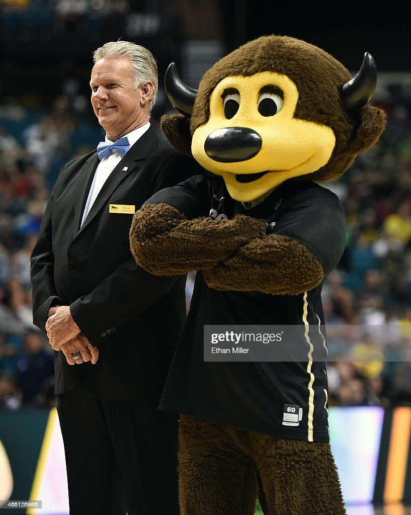 Colorado Buffaloes mascot Chip jokes around with MGM Grand usher Kevin Goe during a quarterfinal game of the Pac-12 Basketball Tournament against the Oregon Ducks at the MGM Grand Garden Arena on March 12, 2015 in Las Vegas, Nevada. Oregon won 93-85.