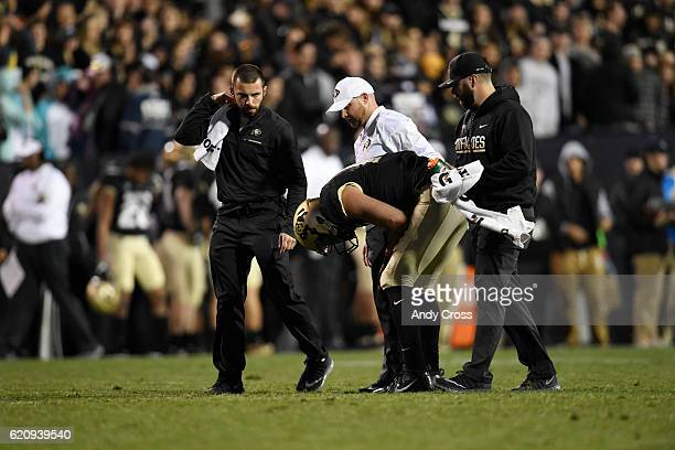 Colorado Buffaloes quarterback Sefo Liufau attended to by trainers in the second quarter during the game against UCLA at Folsom Field November 03 2016