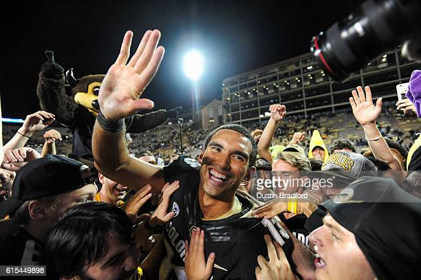 Colorado Buffaloes quarterback Sefo Liufau celebrates with fans who had rushed the field after a 4016 win over the Arizona State Sun Devils at Folsom...