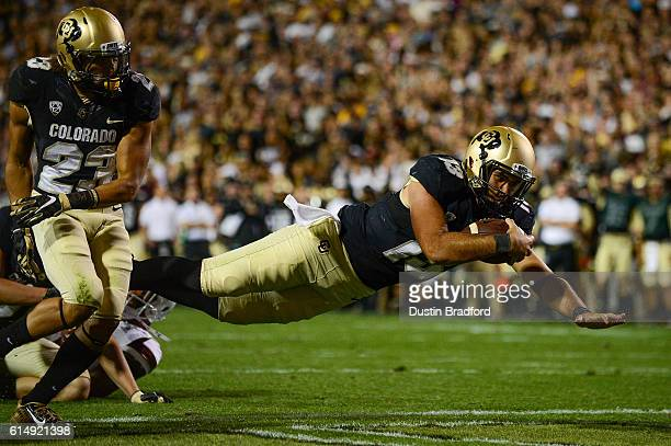 Colorado Buffaloes quarterback Sefo Liufau dives for a first half touchdown against the Arizona State Sun Devils at Folsom Field on October 15 2016...