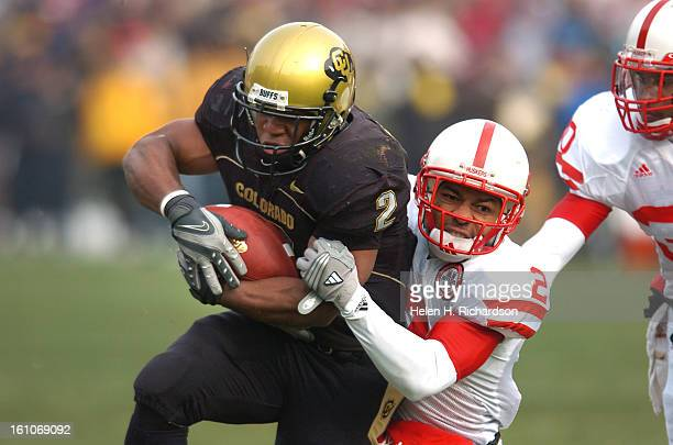 Colorado Buffs tailback Hugh Charles gains 19 yards for a first down in the first quarter Pulling him down at the 6 yard line is Cornhuskers...