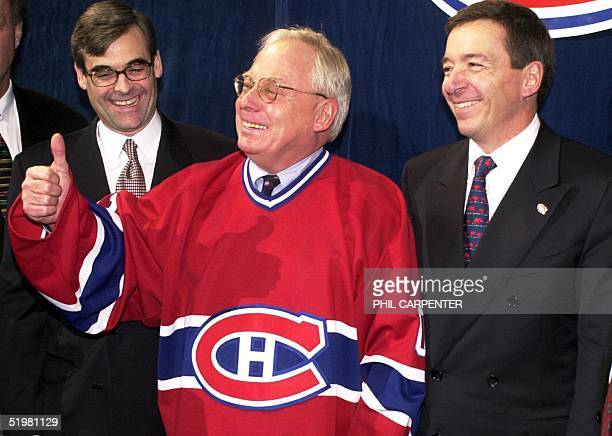 Colorado businessman George N Gillett Jr gives a thumbs up at a press conference 31 January 2001 in Montreal Canada announcing he will be new...