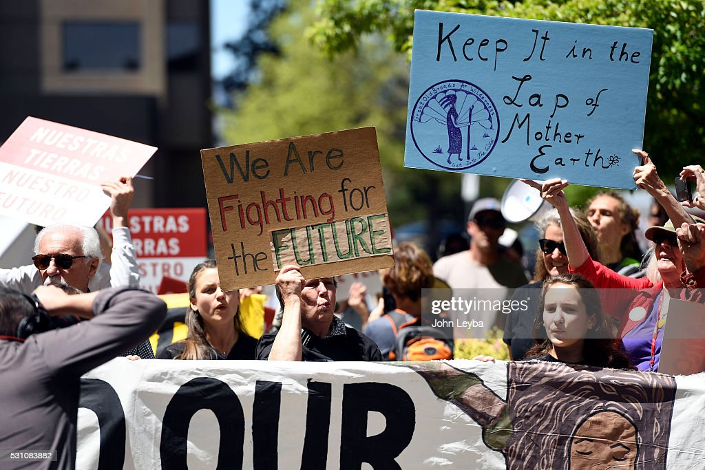 Colorado community, climate and fracking activists hold up