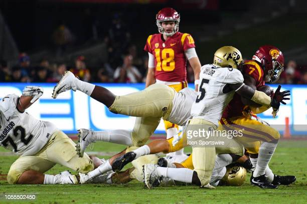 Colorado Davion Taylor tackles USC Stephen Carr during the first quarter of a college football game between the Colorado Buffaloes and the USC...