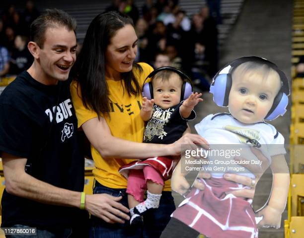 Colorado fans Brian Schlatter left his wife Julia and daughter Alexis 9monthsknow as the Brick Baby now has her own cut out for the CU student section