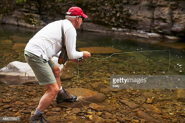 usa, colorado, fisherman on riverbank - water's edge stock pictures, royalty-free photos & images