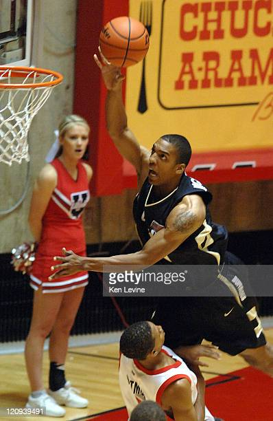 Colorado forward Jeremy Williams soars over Utahs Curtis Eatmon and score a layup at the Huntsman Center in Salt Lake City Tuesday Nov. 21, 2006.