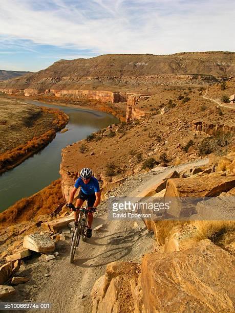 usa, colorado, fruita, man riding mountain bike - fruita colorado stock pictures, royalty-free photos & images