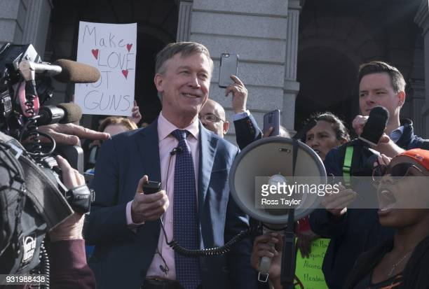 Colorado Gov John Hickenlooper addresses a crowd of several hundred students as they protest against gun violence in front of the Colorado State...