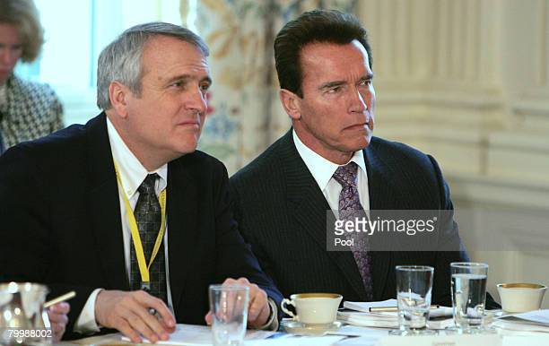 Colorado Governor Bill Ritter and California Governor Arnold Schwarzenegger llisten as US President George W Bush speaks to the National Governors...
