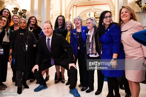 Colorado Governor elect Jared Polis stands with members of the state house and senate for a photo op before his inauguration at the Colorado State...