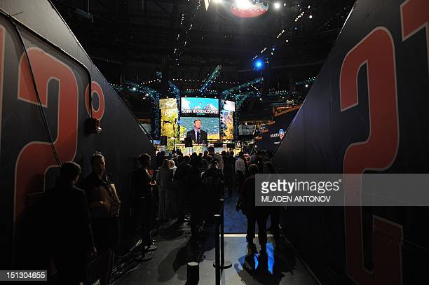 Colorado Governor John Hickenlooper appears on a giant screen as he speaks at the Time Warner Cable Arena in Charlotte North Carolina on September 5...