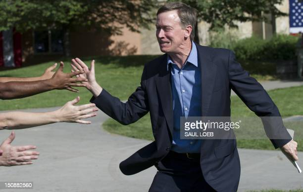 Colorado Governor John Hickenlooper greets supporters prior to a rally with US President Barack Obama at Colorado State University in Fort Collins...