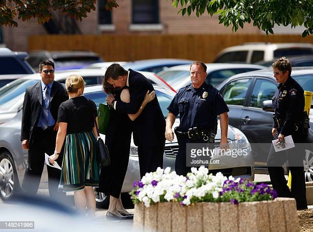 Colorado Governor John Hickenlooper hugs his wife Helen Thorpe after leaving the memorial service for their Gordon Cowden at Pathways Church July 25...