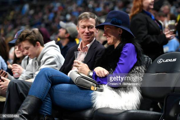 Colorado governor John Hickenlooper left sits with his wife Robin Pringle as they watch the Denver Nuggets take on the Phoenix Suns at the Pepsi...