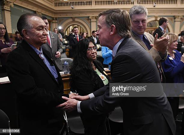 Colorado Governor John Hickenlooper right greets Clement Frost chairman of the Southern Ute Tribal Council moments before giving his State of the...