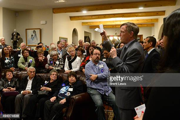Colorado Governor John Hickenlooper speaks about why he wants Hillary Clinton for the next president during a organizing event October 26 2015 at Ken...