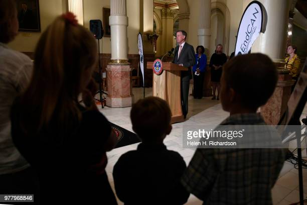 Colorado Governor John Hickenlooper speaks during a press conference inside the west foyer of the State Capitol on June 18 2018 in Denver Colorado...