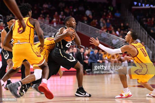 Colorado guard McKinley Wright IV is trapped by guard Elijah Stewart guard Jonah Mathews and guard Jordan McLaughlin during a college basketball game...