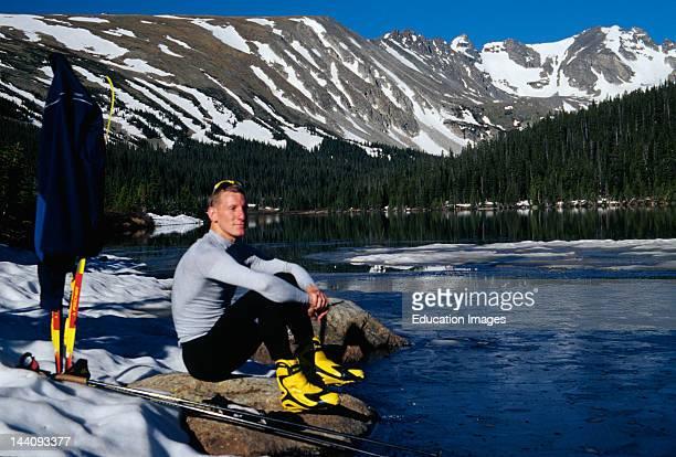 Colorado Indian Peaks Wilderness Area Man Sitting Next To Lake