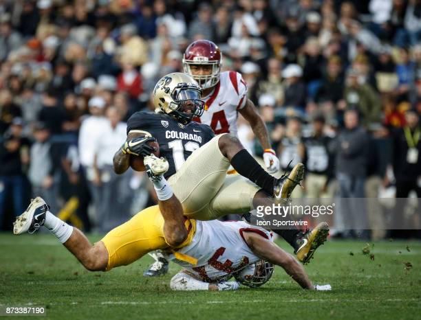 Colorado kick returner KD Nixon gets upended by USC's Matt Lopes during the Colorado Buffalos game versus the USC Trojans on November 11 at Folsom...