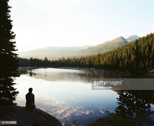 USA, Colorado, Larimer County, Rocky Mountain National Park, Silhouette man looking at sunrise