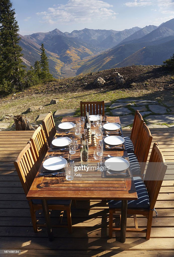 USA, Colorado, Outdoor table and chairs on wooden terrace : Stock Photo