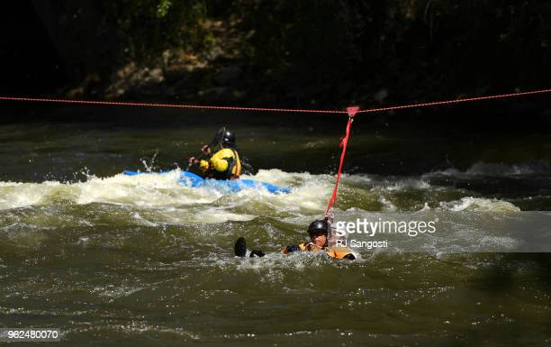 Colorado Parks and Wildlife along with members from local fire departments train with swift water rescue techniques on the Arkansas River on May 25,...