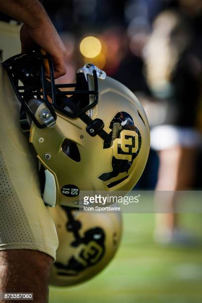 Colorado player holds his helmet during the National Anthem before the Colorado Buffalos game versus the USC Trojans on November 11 at Folsom Field...